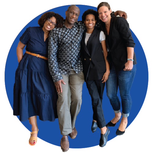 Picture of four team members from the African Collaborative for Health Financing Solutions project. One man and three women standing next to each other smiling.
